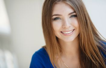 smiling young woman with long hair