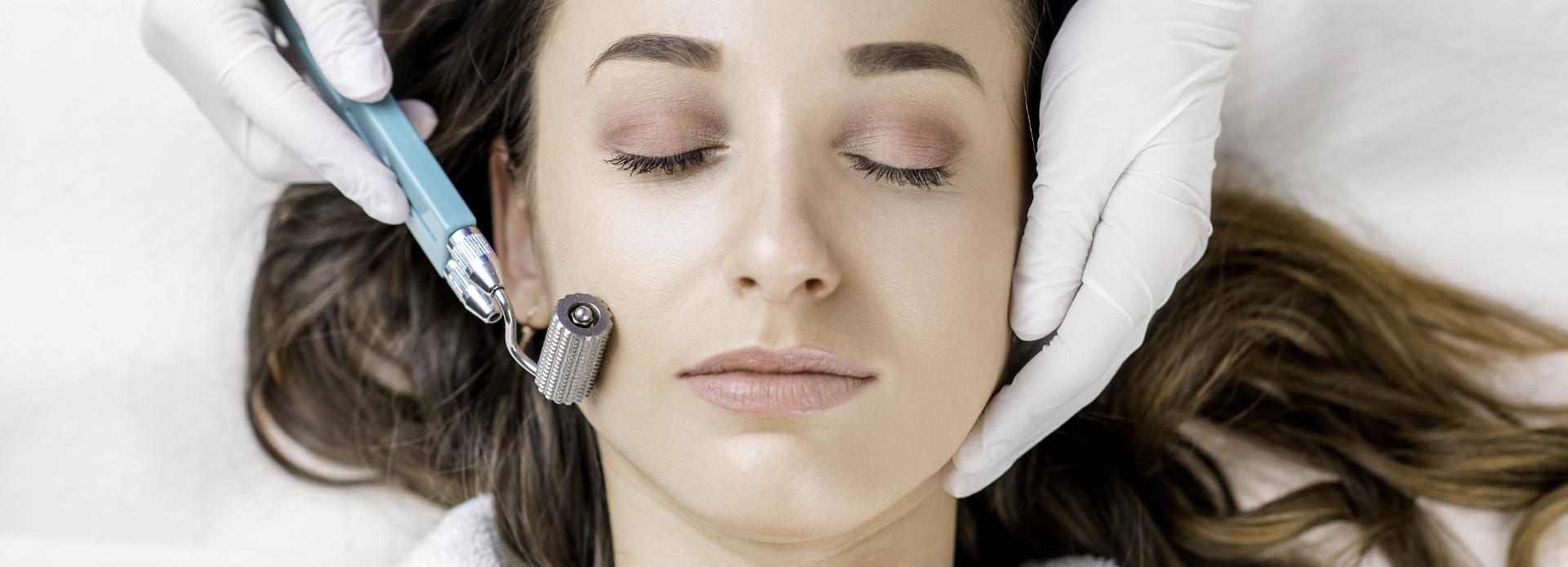 face of a beautiful woman during a cosmetic procedure
