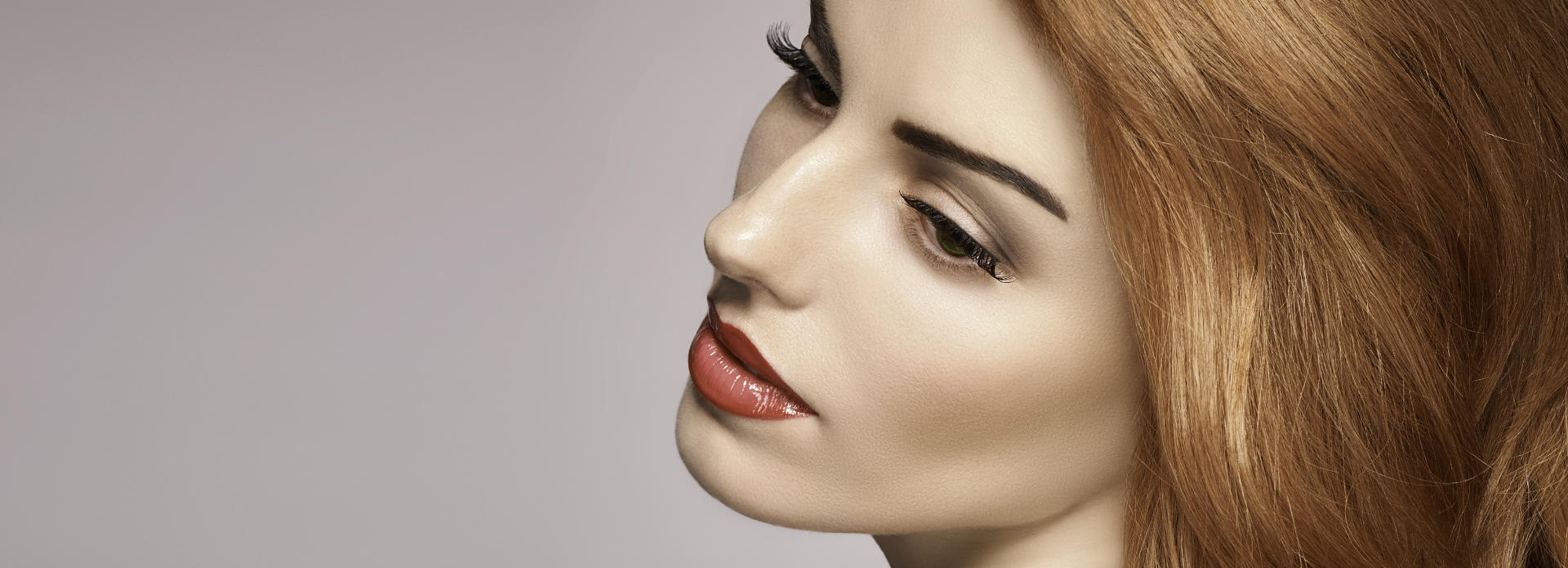Face of a beautiful woman with flowless skin after clear+brilliant laser treatment.
