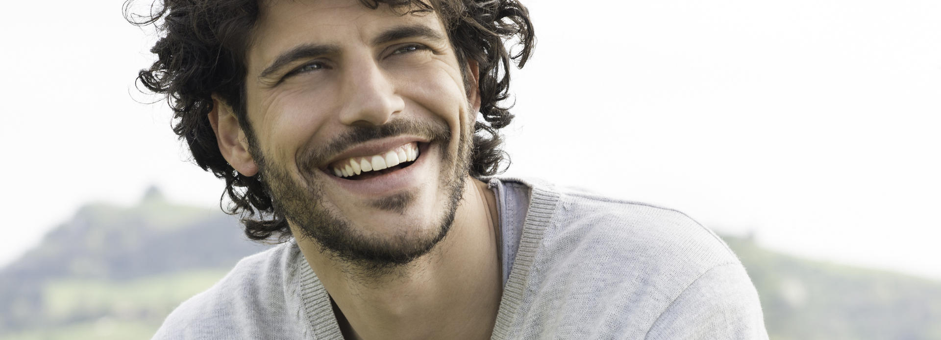 smiling handsome man with curly hair