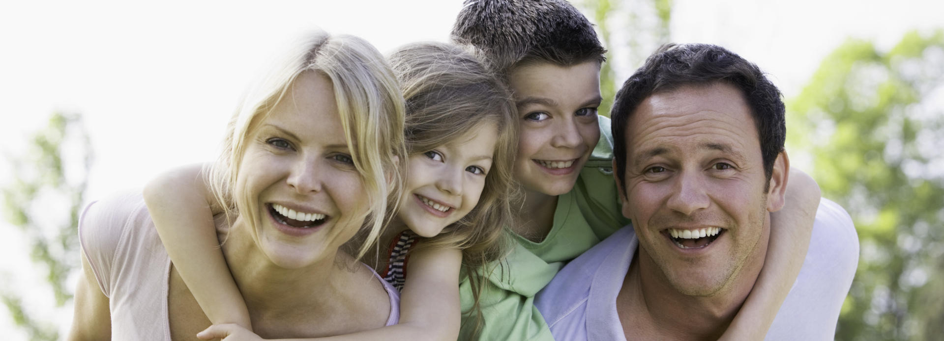 smiling family with children