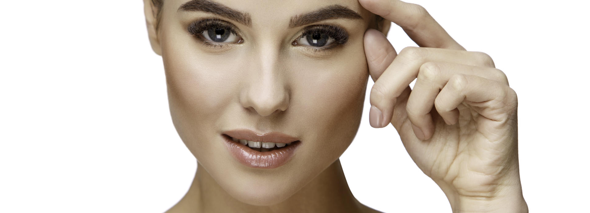 Face of a young-looking woman after cosmetic facial filler treatment.