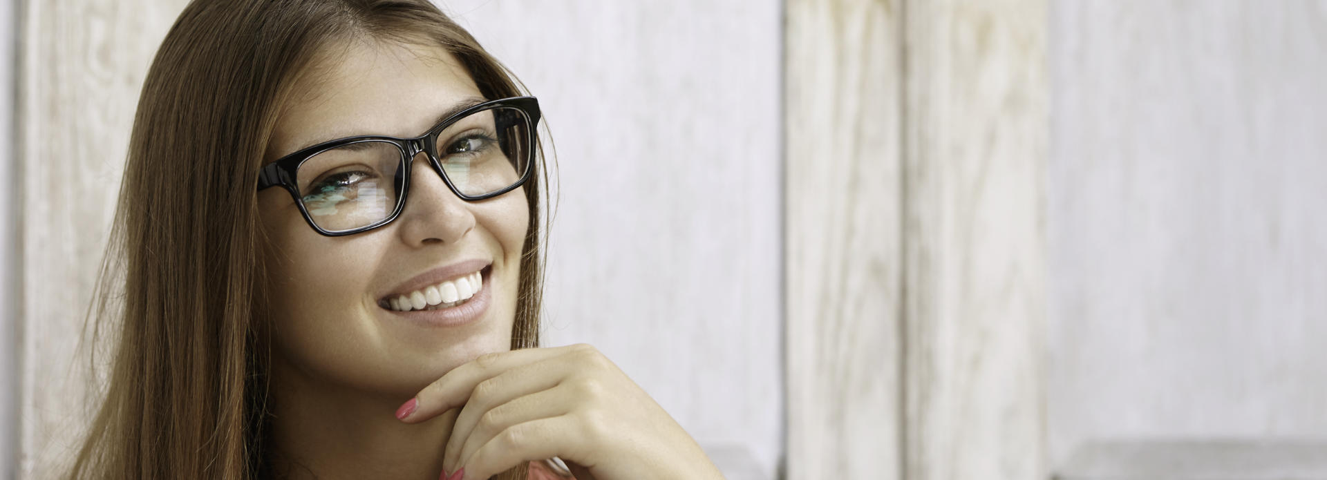 cheerful woman in glasses