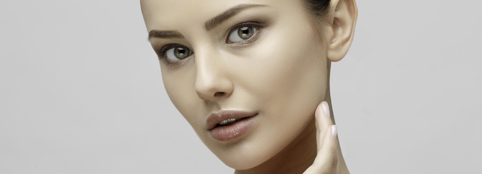 Face of a woman with flawless skin after facial laser treatment.