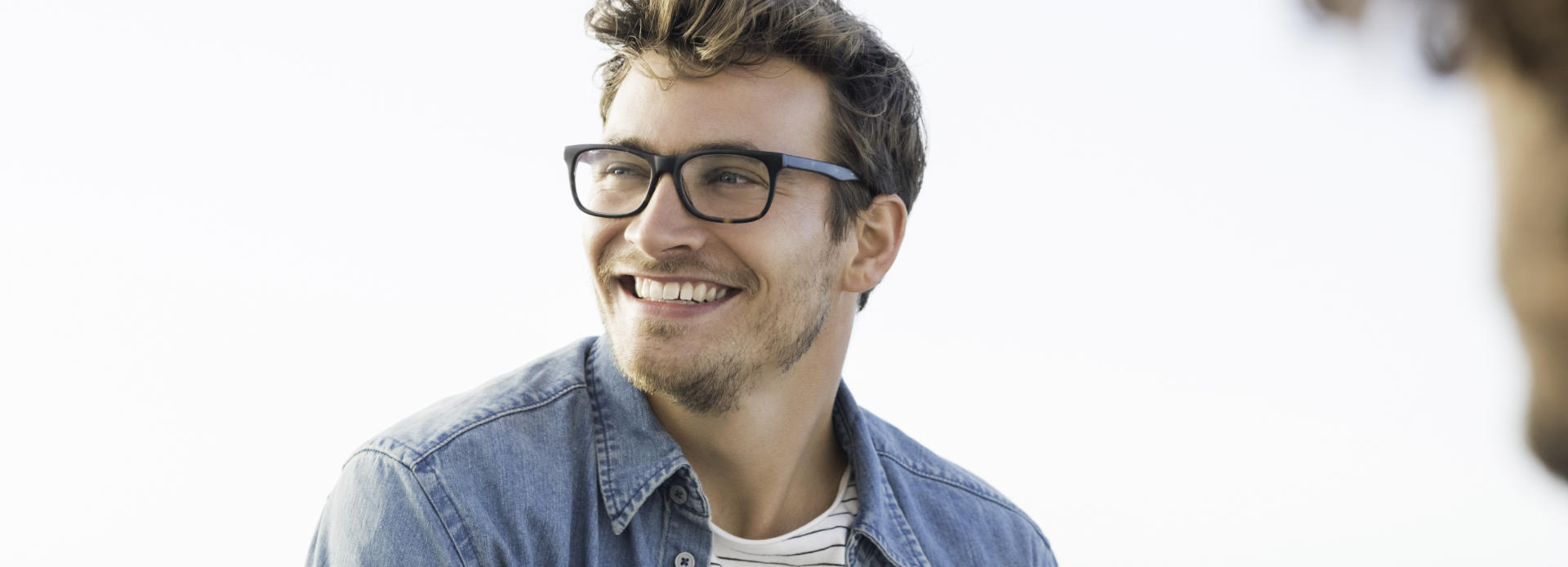 cheerful man in glasses