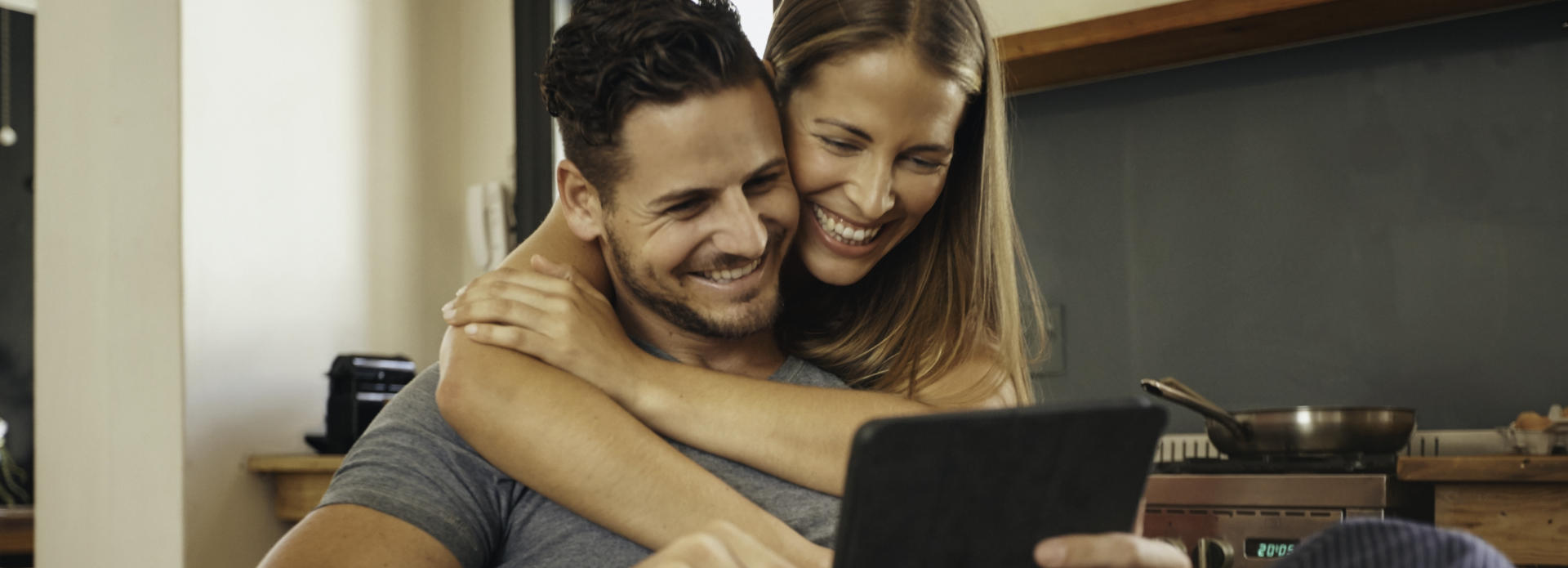 happy couple looks at the tablet
